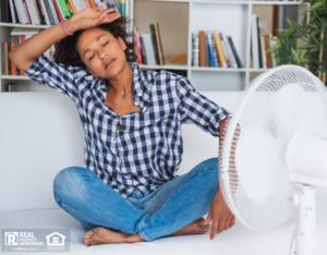 Overheated Woman Sitting in Front of Fan