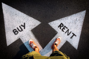 image of a person standing on two white arrows pointing at a 45 degree angle away from each other with the word buy in one and the word rent in the other