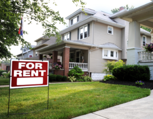 Big Rapids Rental Property with a For Rent Sign in the Front Yard