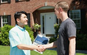 A potential resident shaking the hand of his landlord