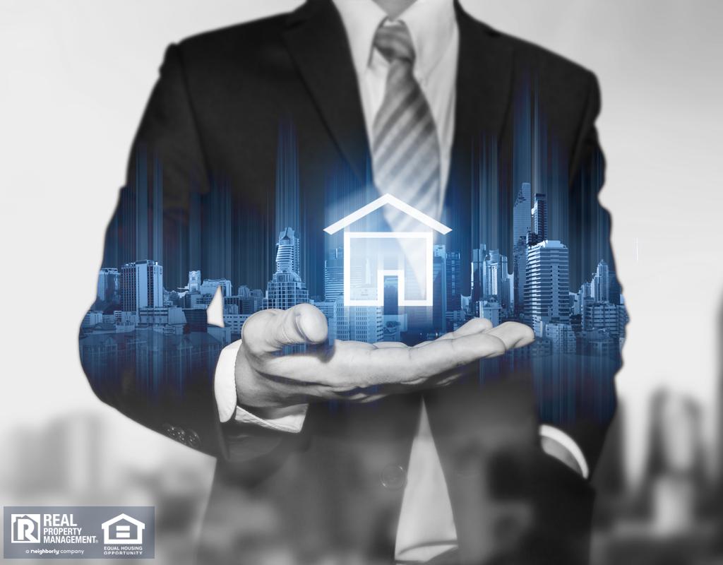 Businessman holding modern buildings hologram