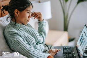 Woman looking at houses for sale online