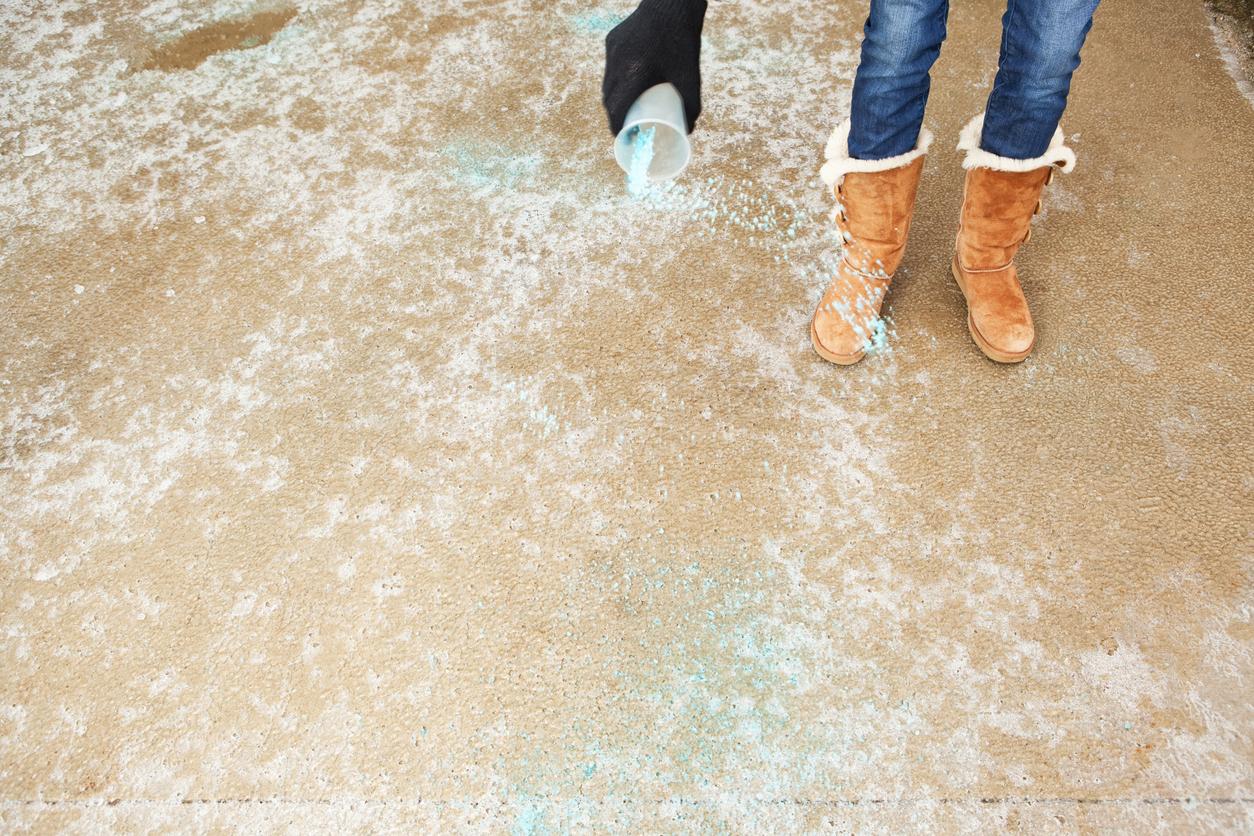 Brooklyn Resident Spreading Salt on an Icy Winter Driveway