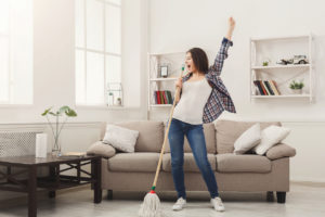 Jamaica Woman Tidying the Living Room