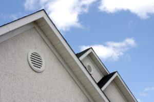 Stucco Roof Peaks Against a Blue Sky