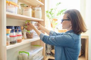 Flushing Tenant Organizing the Pantry in Their Kitchen