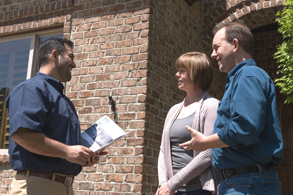RPM Wasatch property manager speaking with tenants outside house