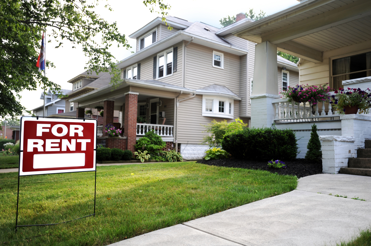 Sandy Rental Property with a For Rent Sign in the Front to Attract New Renters
