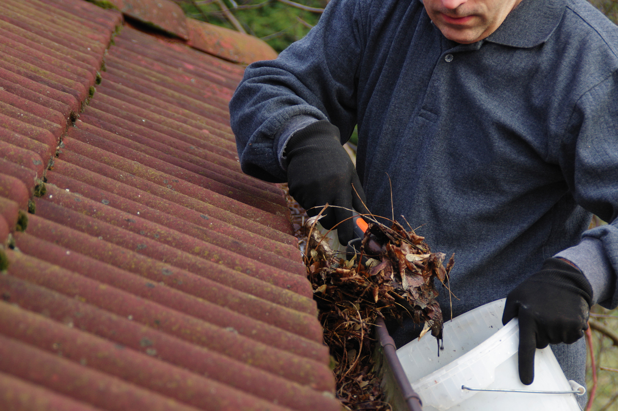Taylorsville Rental Property Owner Cleaning the Gutters for Spring Cleaning