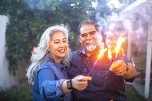 Sandy Couple Holding Sparklers Together
