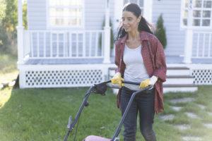 Salt Lake City Woman Mowing the Lawn