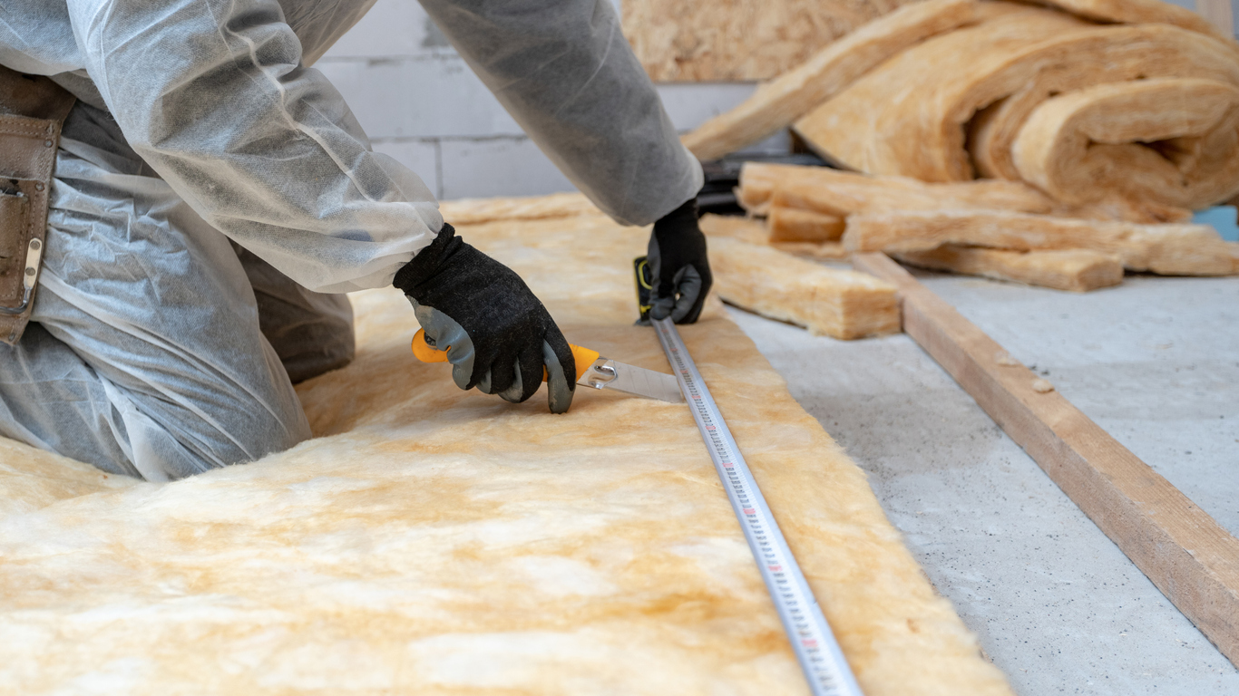 Professional installing thermal insulation rock wool