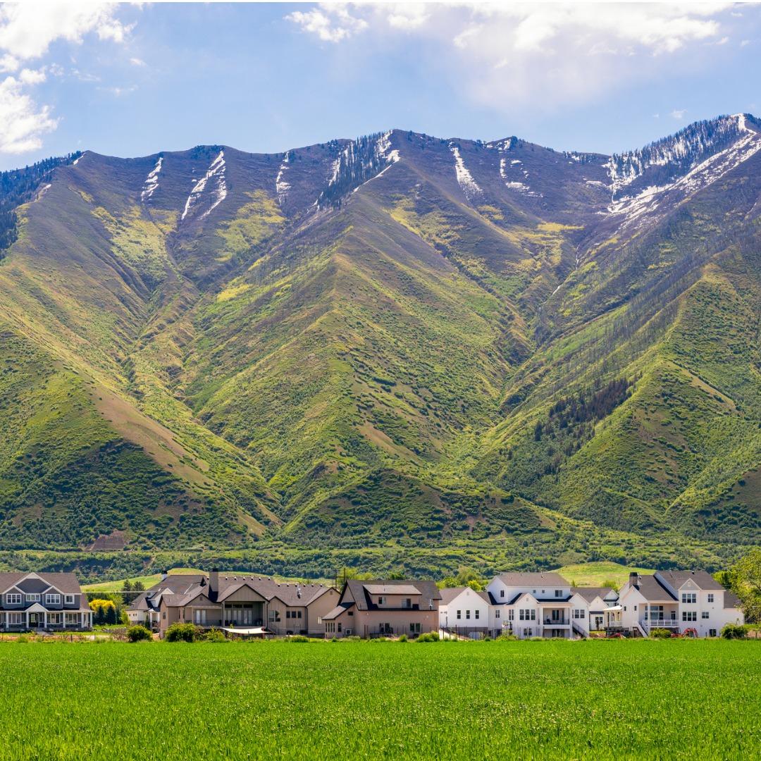 Large homes nestled against the Utah mountains