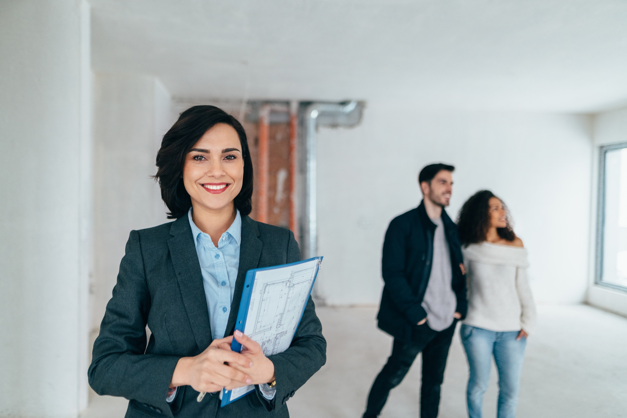 Property manager showing new home to clients