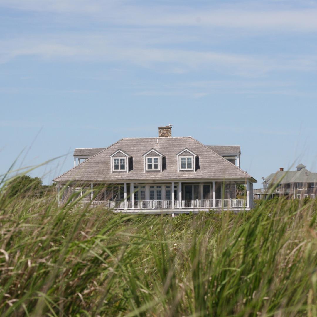 Beach house with grass near Huntington, New York