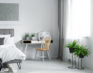 Pristine Bedroom with A Pair of Ferns by the Window