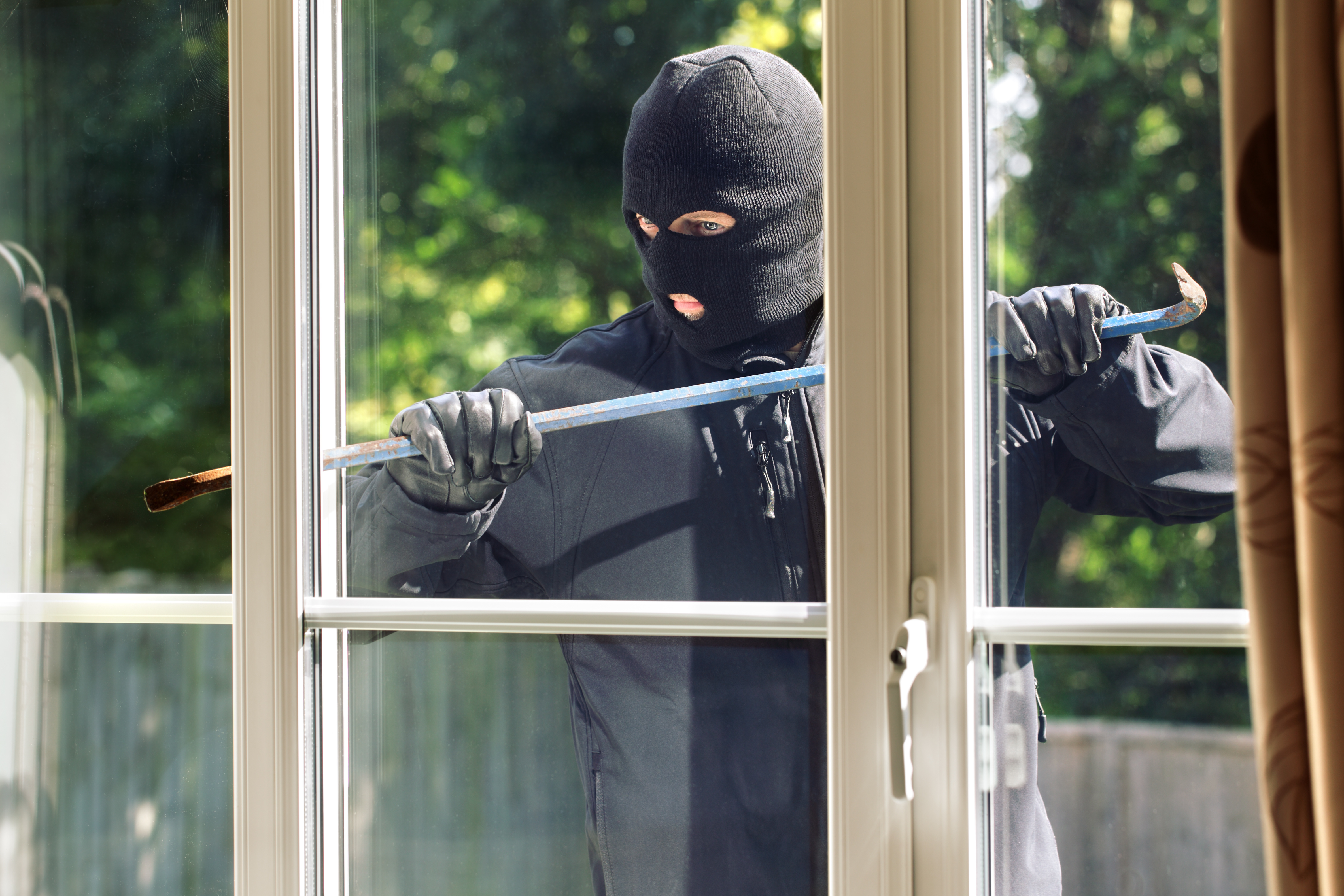 Robber Trying to Break into a House During Your Summer Vacation