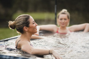 Young Women Relaxing in Hot Tub on Rental Property