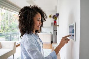 Clovis Woman Adjusting Home Security System