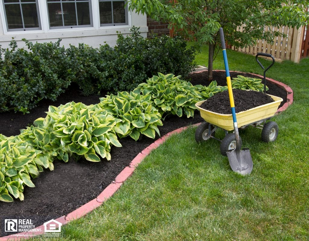 Low-MaintenanceHostas with Mulch in River Park Rental Property Yard