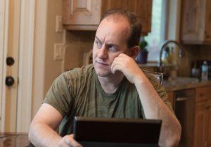 A Temecula property investor at his computer