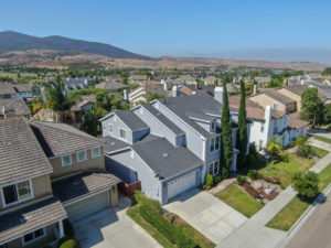 Aerial view of suburban neighborhood street with big villas next to each other in Black Mountain, San Diego, California, USA. Aerial view of residential modern subdivision big luxury house
