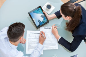 Man and woman working on rental agreement. 5 Questions NOT to ask a Potential Rentor