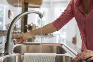 Reno Tenant Using a Water-Efficient Faucet