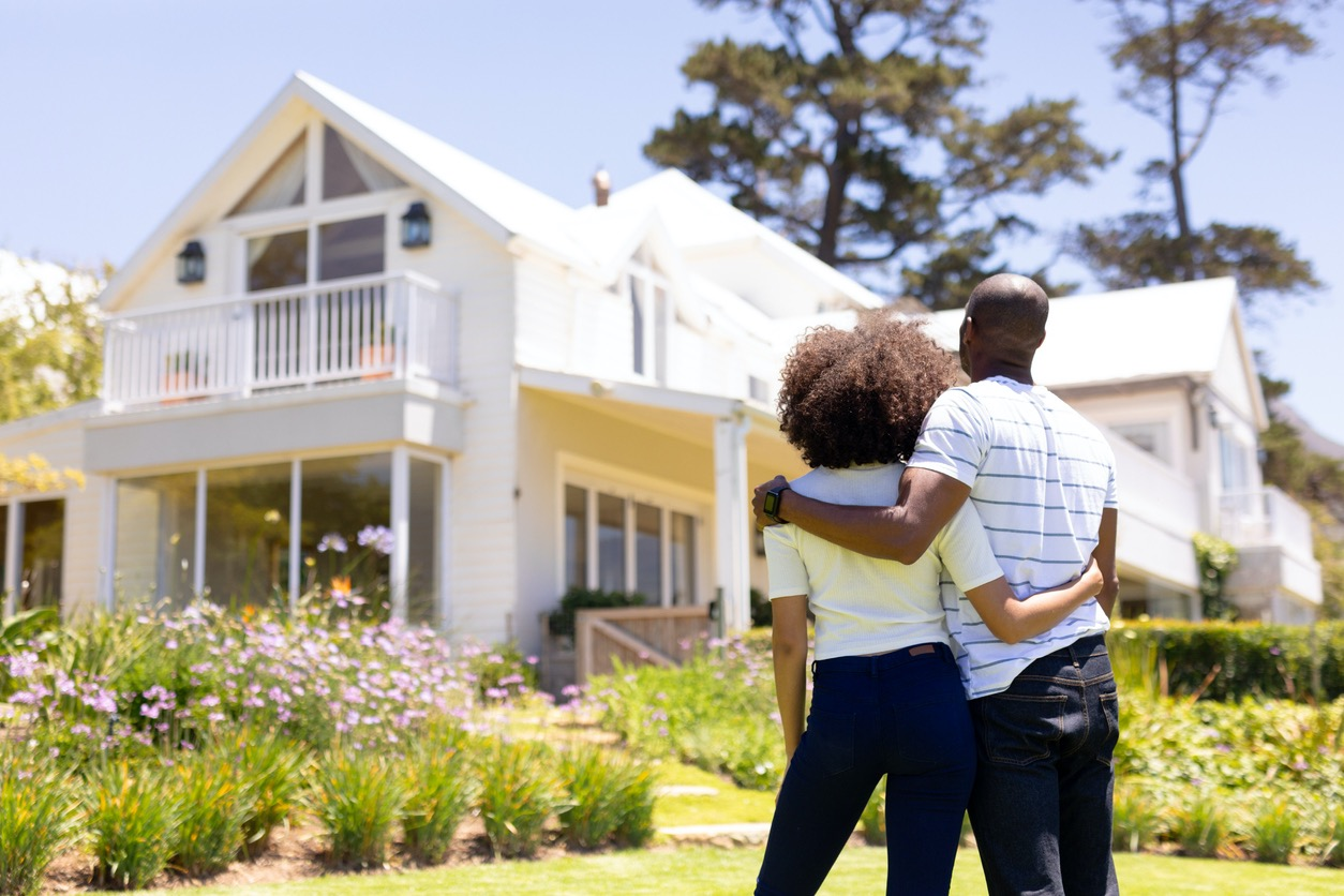 Couple Embracing and Looking at their New Hot Springs Rental Home