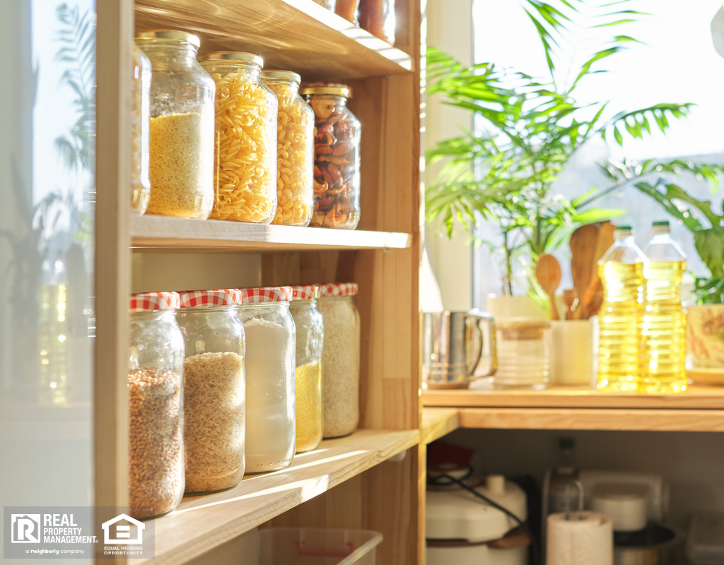 Organized Pantry with Food Items Stored in Glass Containers