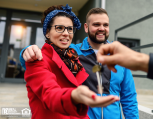 Millennial Couple Receiving House Keys from Property Manager