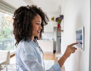 Nashville Woman Adjusting Home Security System