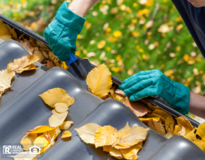 Winter Haven Landlord Clearing a Rental Property's Rain Gutters