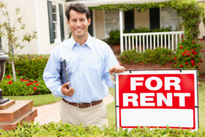 OKC property manager in front of rental property