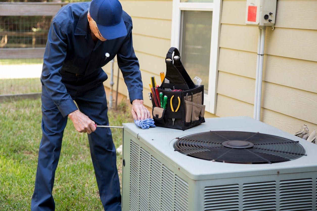 HVAC Technician Servicing an Air Conditioning Unit