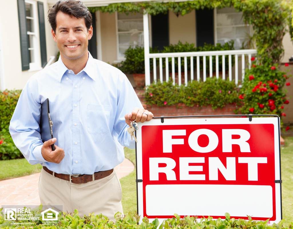 Spring Landlord in Front of a Short-Term Rental