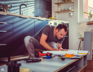 Valle Vista Landlord Repairing the Kitchen Cabinets