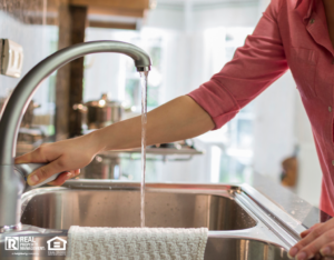 Mohave Valley Tenant Using a Water-Efficient Faucet