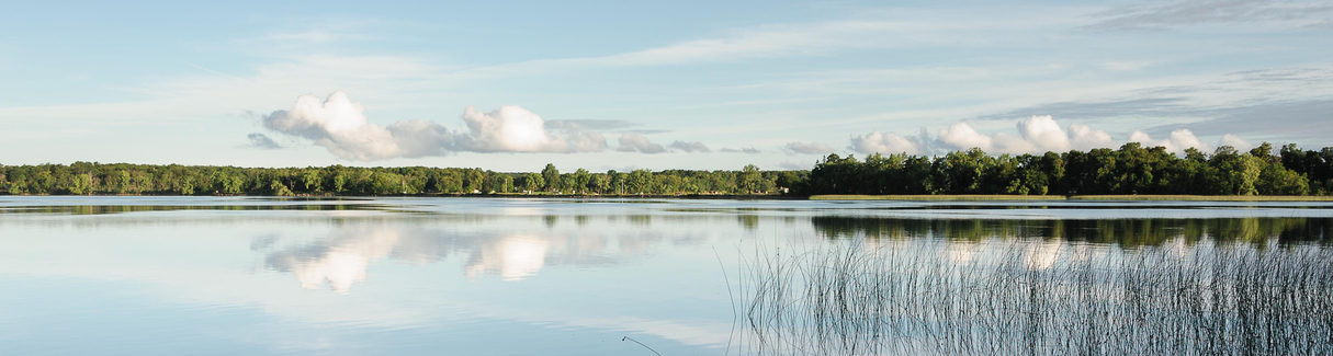 Glassy lake in the early morning. East Battle Lake, Minnesota, USA