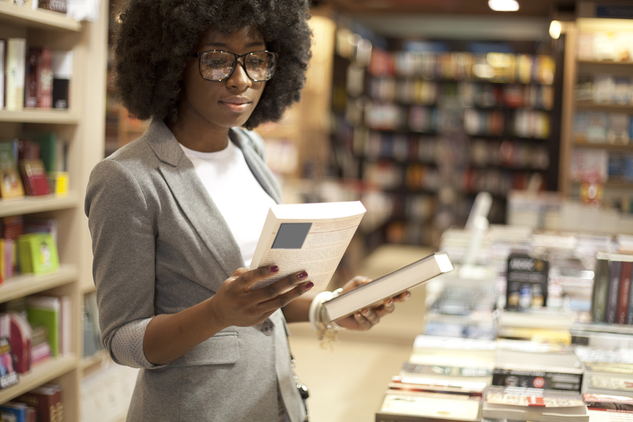 Business Woman Buying Book at Book Store