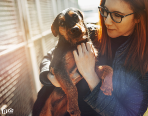 Woman Holding a Rescue Dog
