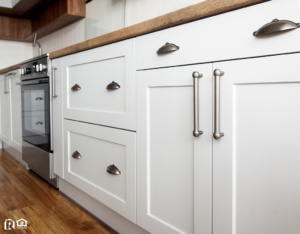Stylish Gray Fixtures on White Kitchen Cabinets