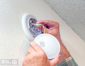 Baytown Property Manager Changing Smoke Detector Batteries