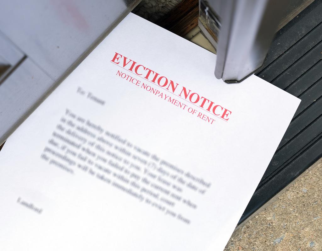 Eviction Notice Slid in an Open Doorway
