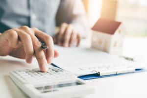 Camarillo Real Estate Investor Crunching Numbers to Determine his ROI