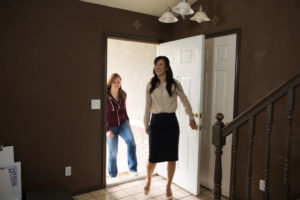 A Miami property manager showing a listing to a resident