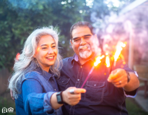 Southwest Waterfront Couple Holding Sparklers Together