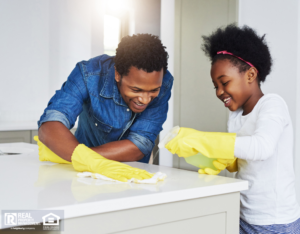 Trinidad Family Cleaning the Kitchen