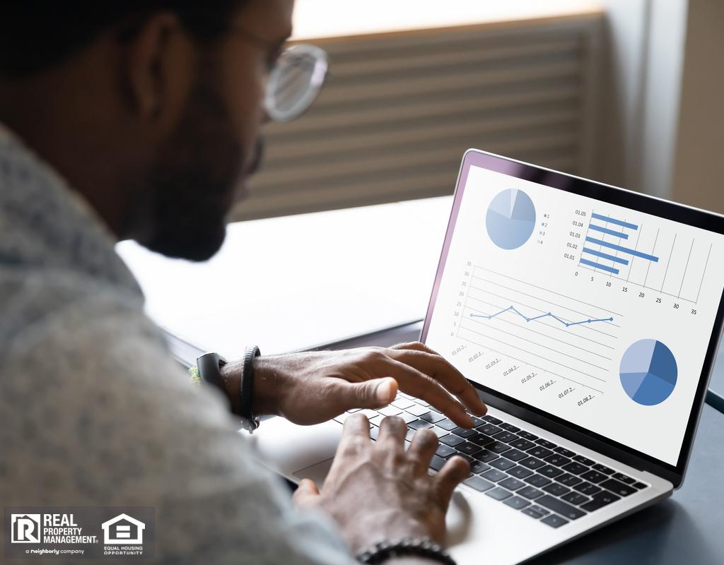 Logan Circle Real Estate Investor Reviewing Data on a Laptop