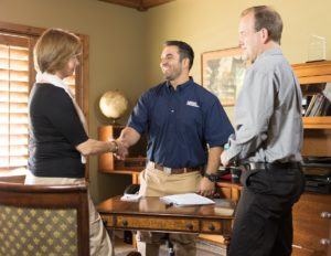 Columbia Property Manager Shaking the Hands of Satisfied Tenants